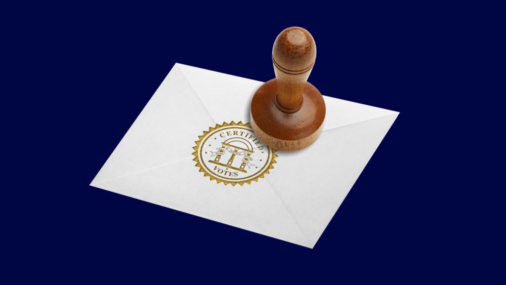 """A wooden stamper embossing a white envelope with a gold seal that says """"CERTIFIED VOTES"""""""