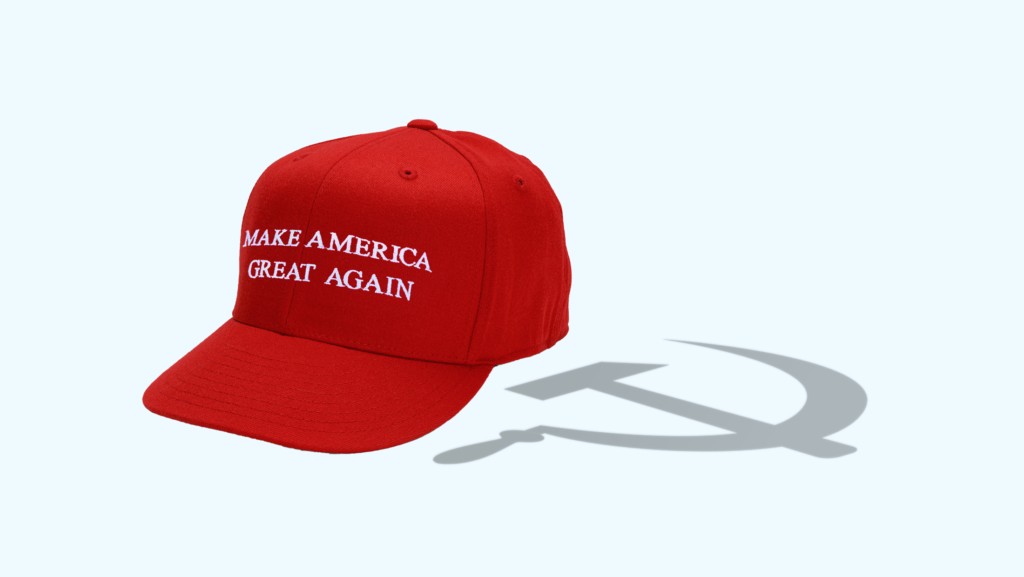 """A red """"MAKE AMERICA GREAT AGAIN"""" hat that is casting a shadow shaped like a communist hammer and sickle"""